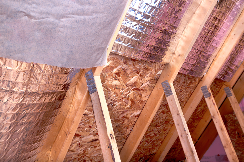 Gable View Of Ongoing House Attic Insulation Project With Heat A